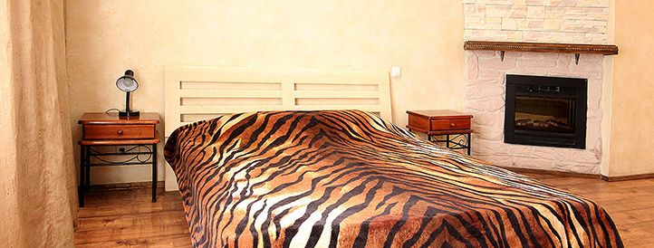 Bedroom with fireplace in Saint Sofia serviced apartment in the center of Kiev